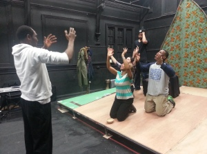 Clement Ule leads the cast in rehearsal dor 2014 spring tour Palm Wine and Stout